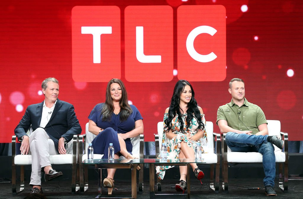 "Image Credits: Getty Images / Frederick M. Brown | (L-R) Matt Sharp, Molly Hopkins, Paola Mayfield, Russ Mayfield of the television show ""90 Day Fiance' Franchise"" for the TLC Network speak during the Summer 2018 Television Critics Association Press Tour at the Beverly Hilton Hotel on July 26, 2018 in Beverly Hills, California."