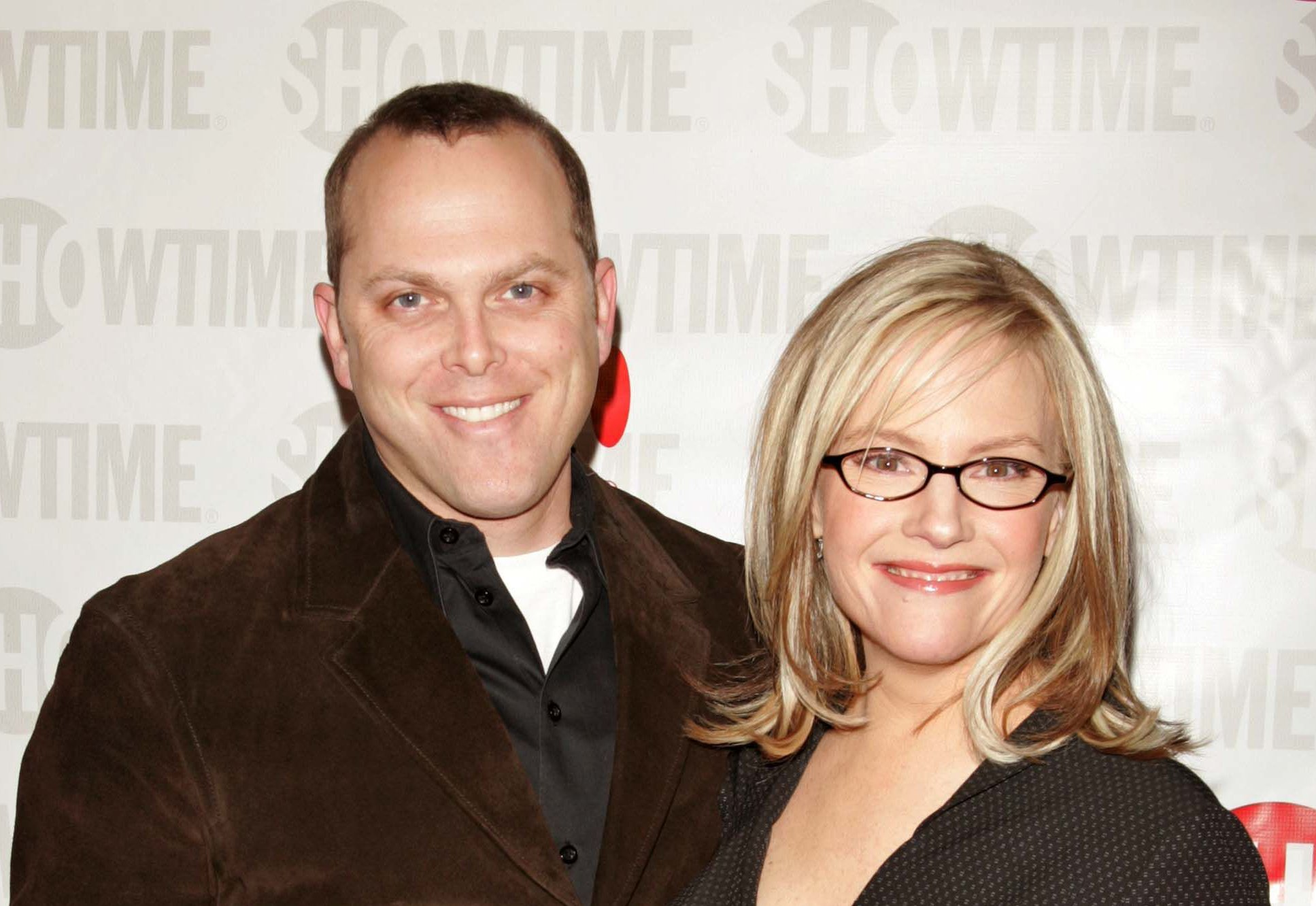 Adam Paul and Rachael Harris / Getty Images