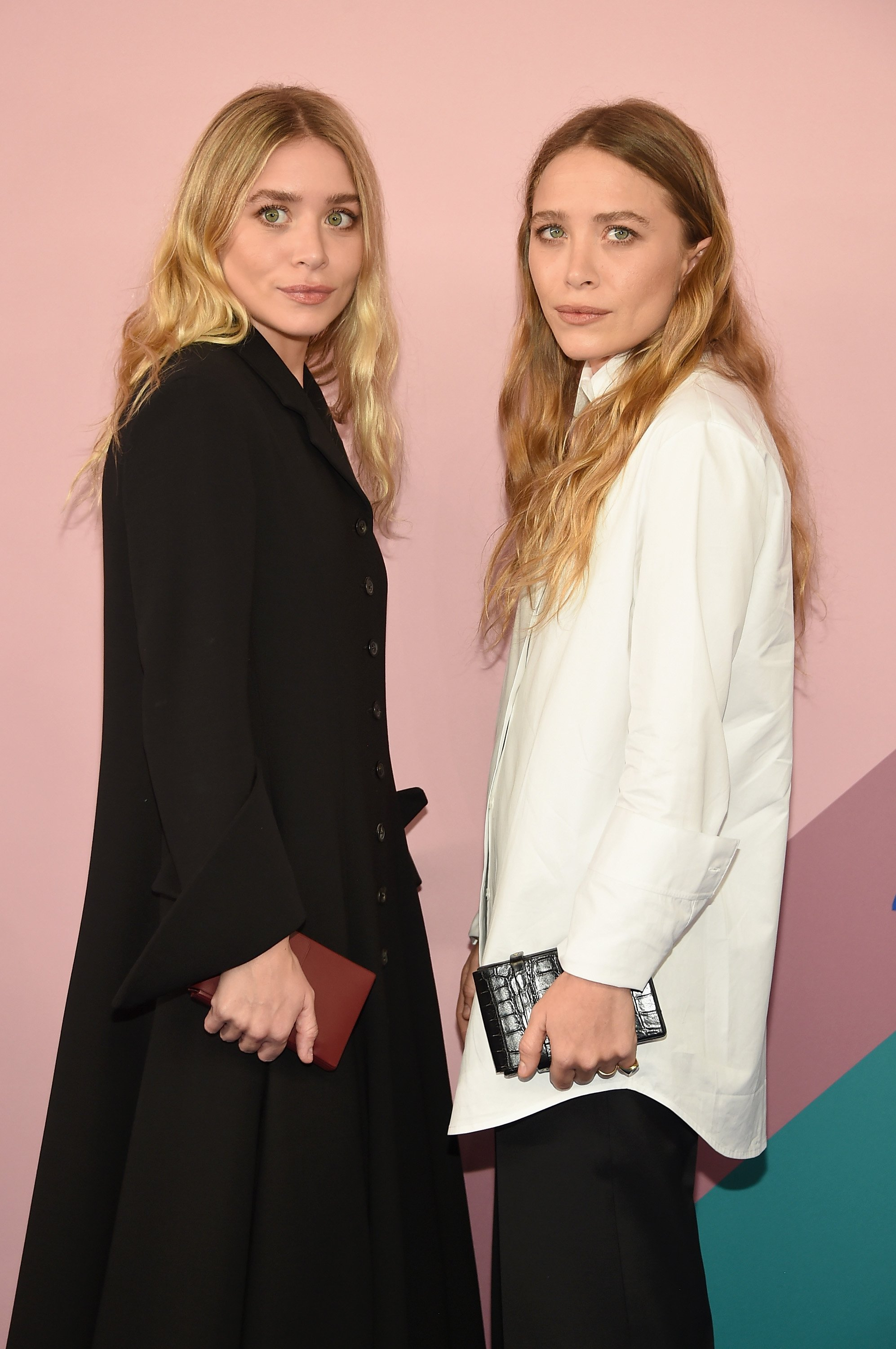 Image Credit: Getty Images/Dimitrios Kambouris | Ashley Olsen and Mary-Kate Olsen attend the 2017 CFDA Fashion Awards