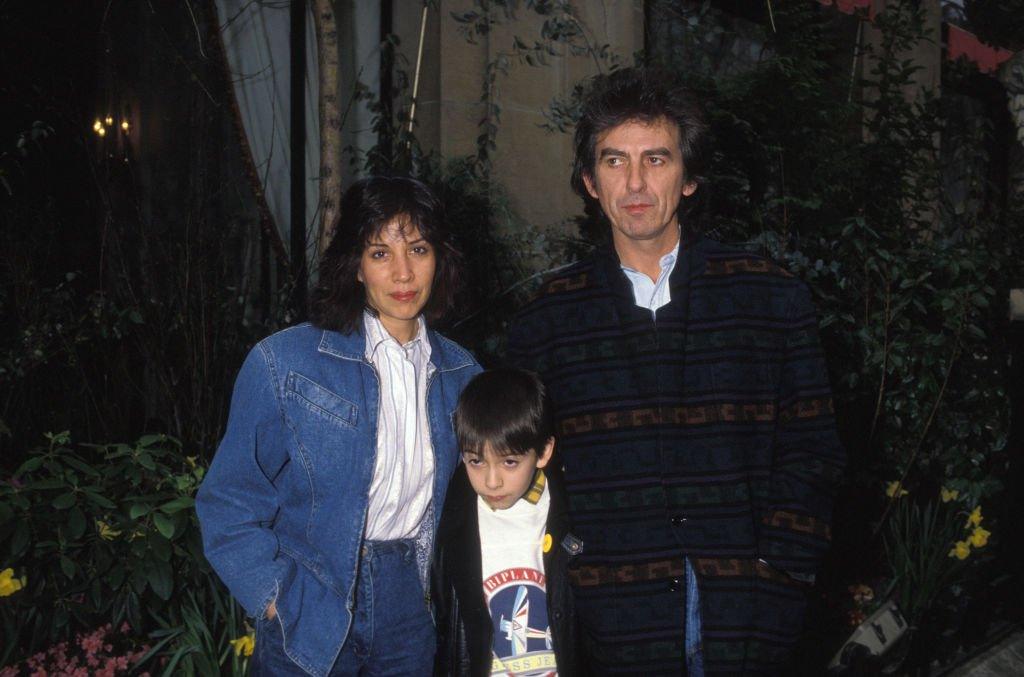 Image Credits: Getty Images / GARCIA / Gamma-Rapho | George Harrison with his wife Olivia, and their son Dhani in Paris, France.