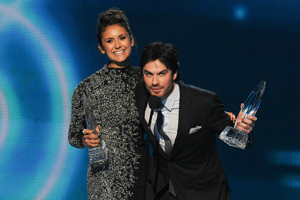 Image Source: Getty Images/Allen Berezovsky/Actors Nina Dobrev (L) and Ian Somerhalder, winners of the Favorite On Screen Chemistry award for 'The Vampire Diaries,' speak onstage at the 40th Annual People's Choice Awards