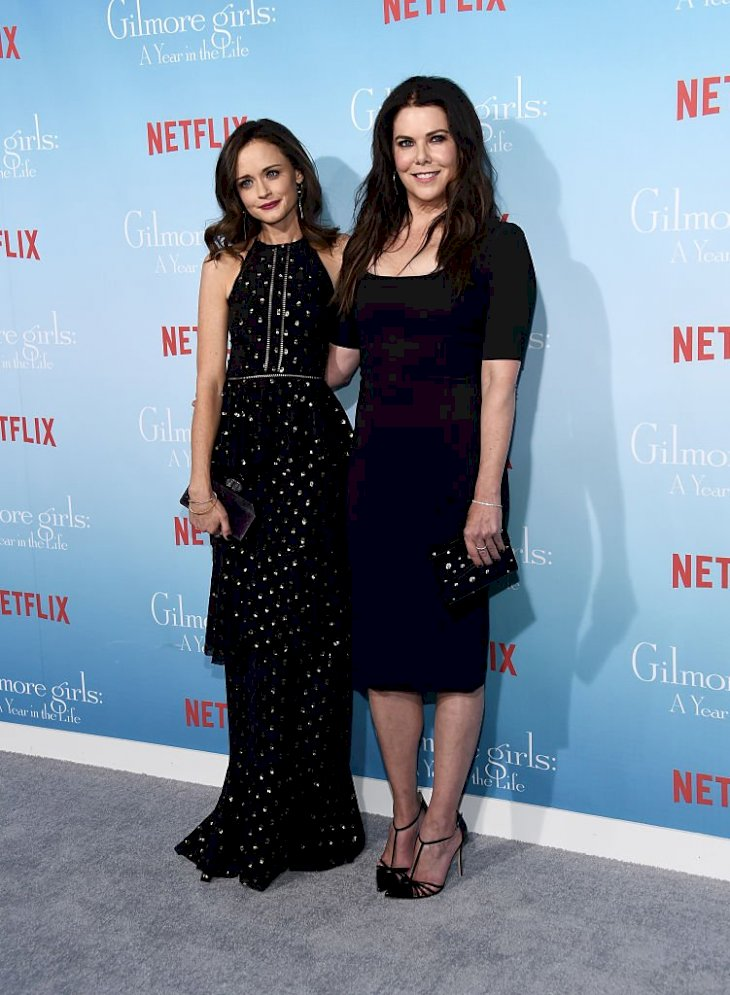 """Image Credit: Getty Images / Actresses Alexis Bledel (L) and Lauren Graham arrive at the premiere of Netflix's """"Gilmore Girls: A Year In The Life""""."""