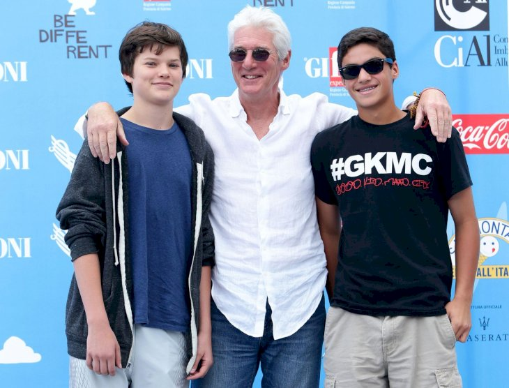 L-R Richard Gere, his son Homer James Jigme Gere (L) and a friend attend Giffoni Film Festival photocall on July 22, 2014 in Giffoni Valle Piana, Italy. (Photo by Stefania D'Alessandro/WireImage)