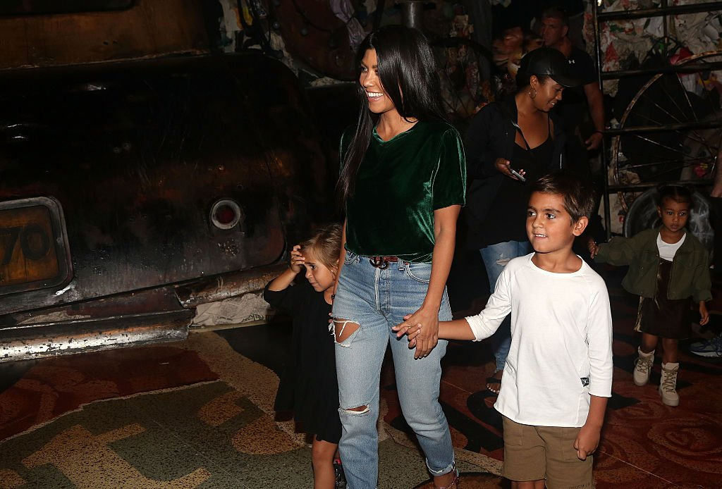 "Image Credit: Getty Images / Kourtney Kardashian, Mason Disick, Penelope Disick and North West backstage at ""Cats"" on Broadway at The Neil Simon Theatre on September 11, 2016 in New York City."