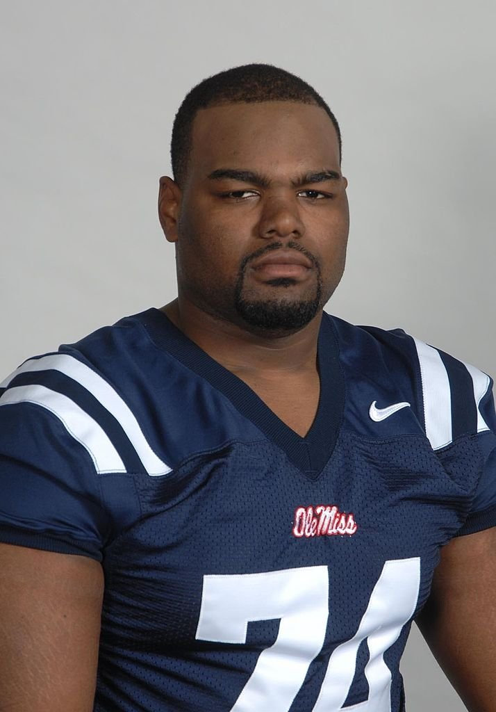 Image Source: Getty Images/Collegiate Images | Michael Oher #74 Left Tackle of the University of Mississippi Rebels poses for a head shot during a game on June 11, 2008