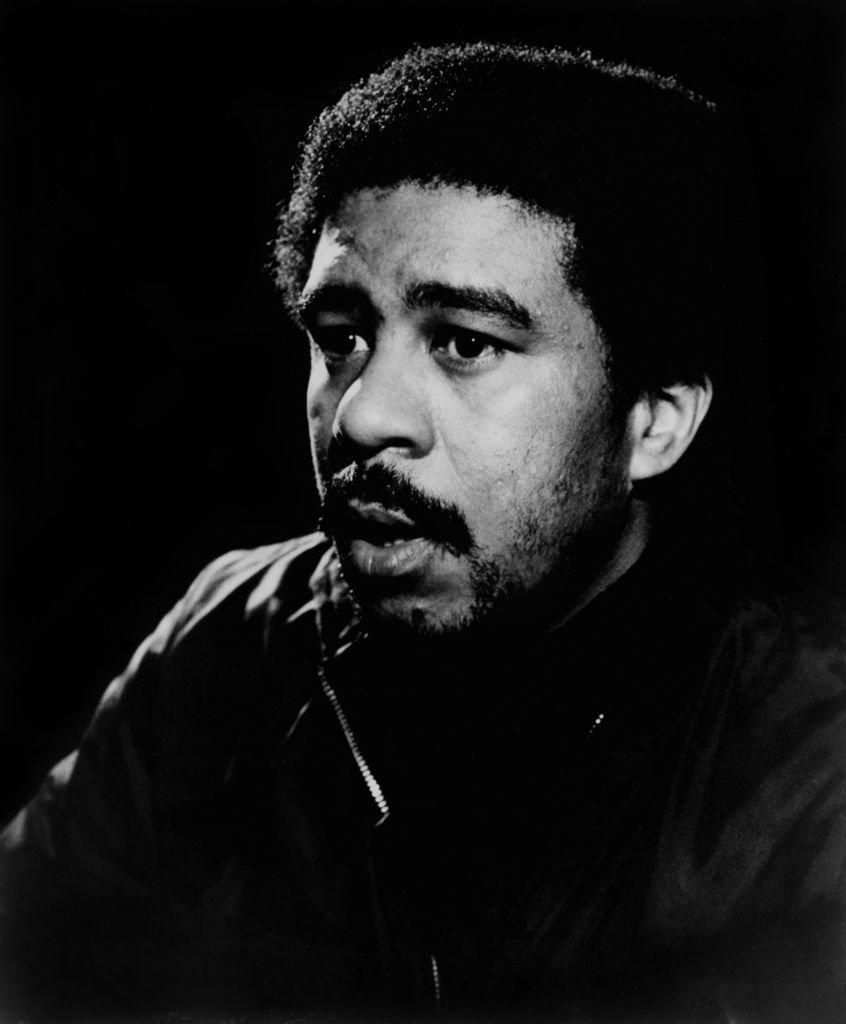 Image Credits: Getty Images / Michael Ochs Archives | Richard Pryor posing for a Stax Records publicity photo in 1974
