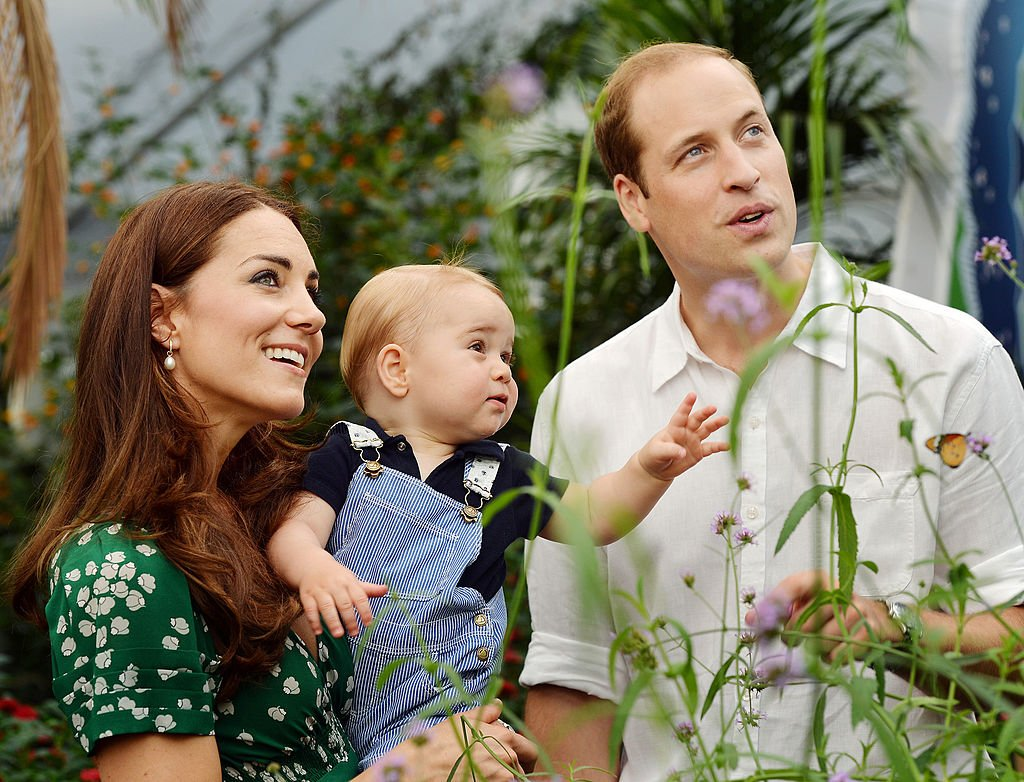Image Credit: Getty Images / Catherine, Duchess of Cambridge holds Prince George with Prince William. The family released the photo ahead of the first birthday of Prince George on July 22.