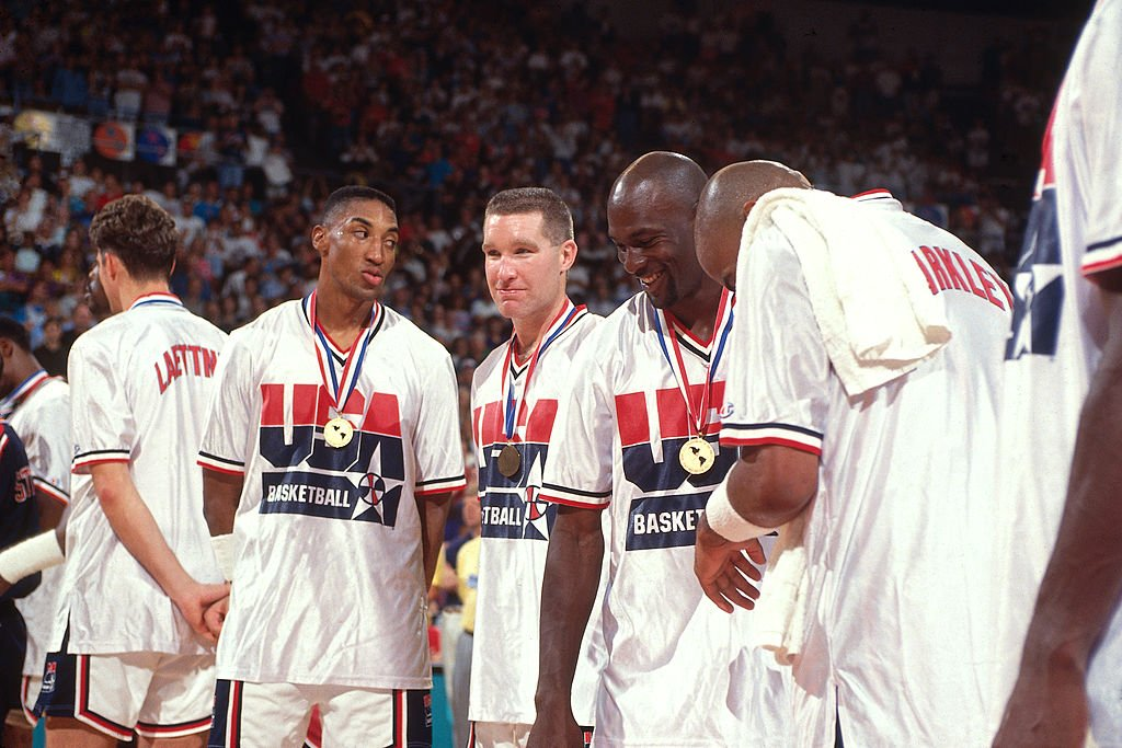 Image Credits: Getty Images / Andrew D. Bernstein / NBAE | Scottie Pippen, Chris Mullin, Michael Jordan and Charles Barkley laugh following the Gold Medal Basketball game between the United States and Croatia at the 1992 Olympics on August 8 1992 at the Palau Municipal d'Esports de badalona in Barcelona, Spain. The United States defeated Croatia 117-85 to win the gold medal.
