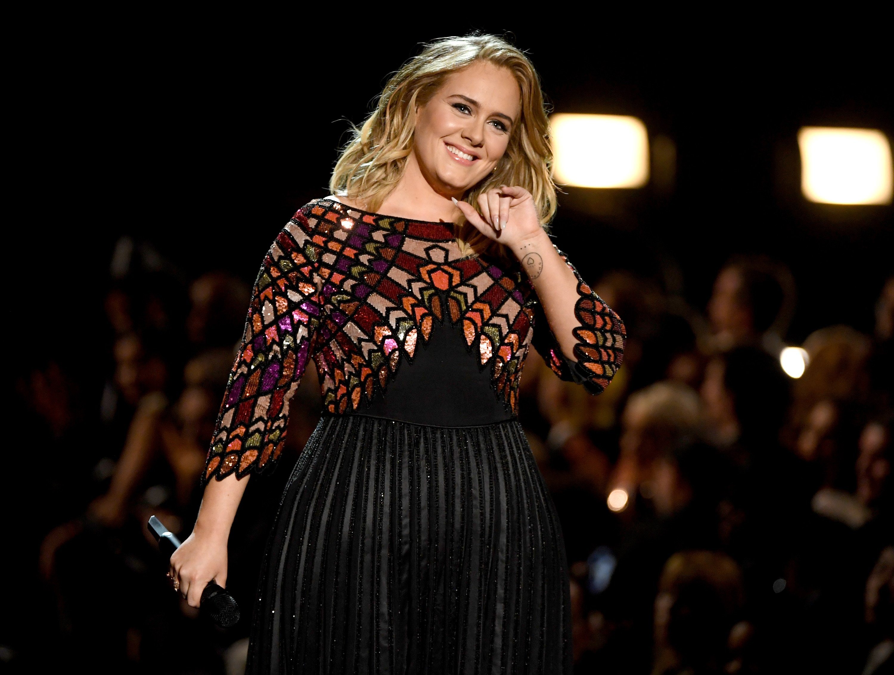 Image Credit: Getty Images / Adele performing at a concert.