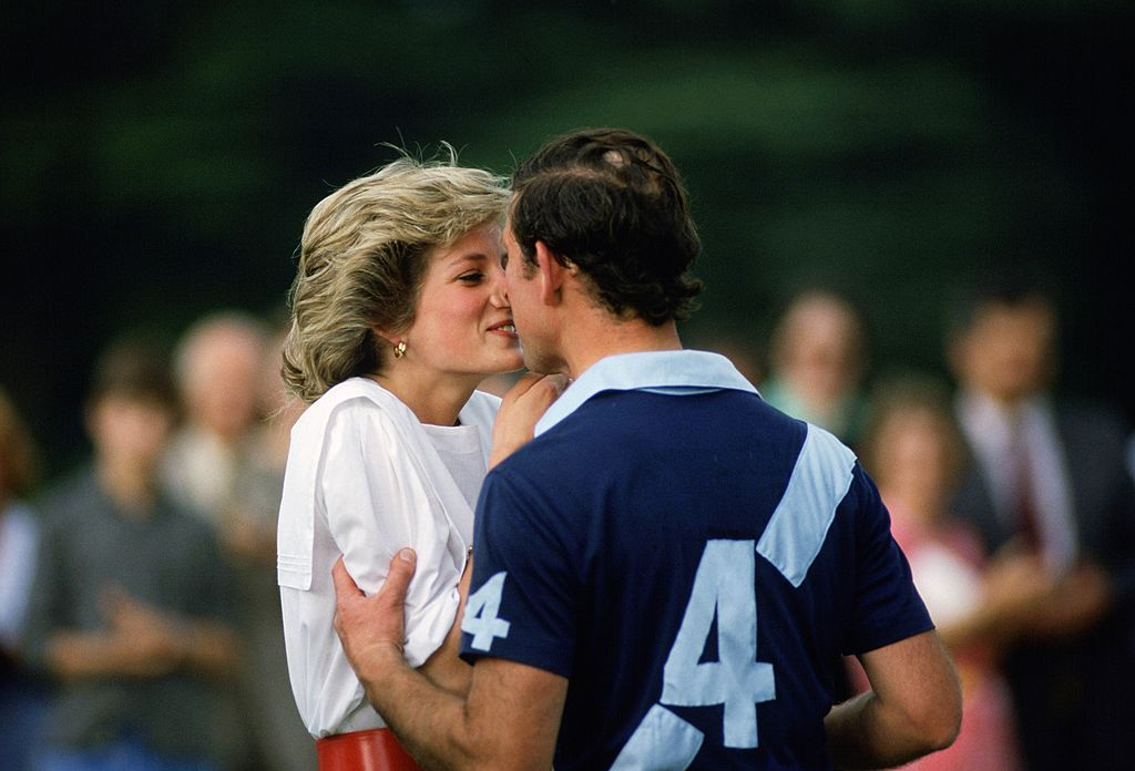 Image credits: Getty Images/Tim Graham Photo Library | Princess Diana and Prince Charles share a tender moment at a Polo Match