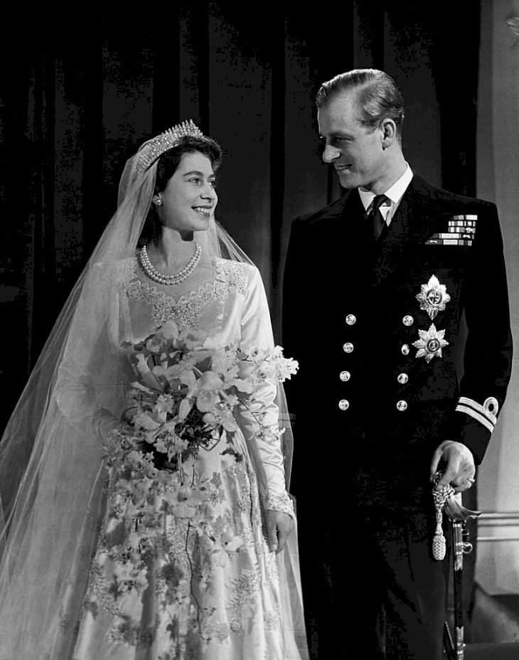 Image Credit: Getty Images/Corbis via Getty Images/CORBIS/© Hulton-Deutsch Collection | Newly wed Queen Elizabeth and Prince Philip
