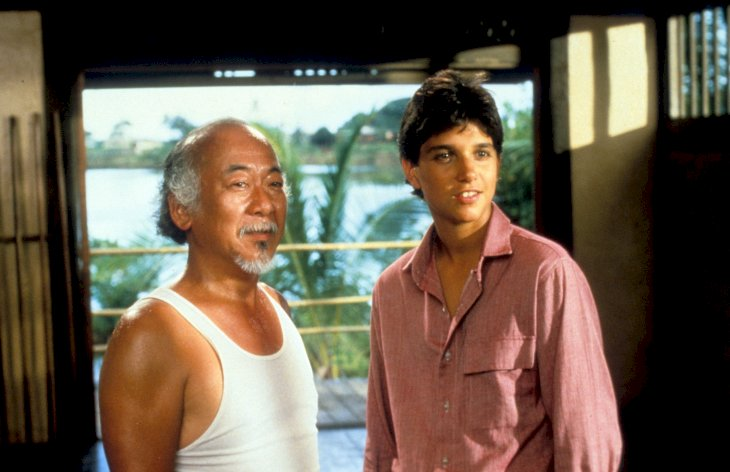 Pat Morita and Ralph Macchio in a scene from the film 'The Karate Kid' / Getty Images
