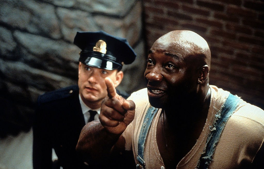 Image Credit: Getty Images / Tom Hanks is guided by Michael Clarke Duncan in a scene from the film 'The Green Mile', 1999.