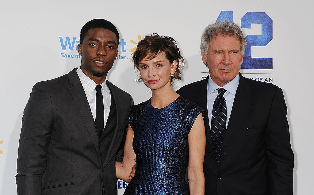 Image Credits: Getty Images / Jeffrey Mayer / WireImage | Actors Chadwick Boseman, Calista Flockhart and Harrison Ford attend the '42' Los Angeles premiere at TCL Chinese Theatre on April 9, 2013 in Hollywood, California.