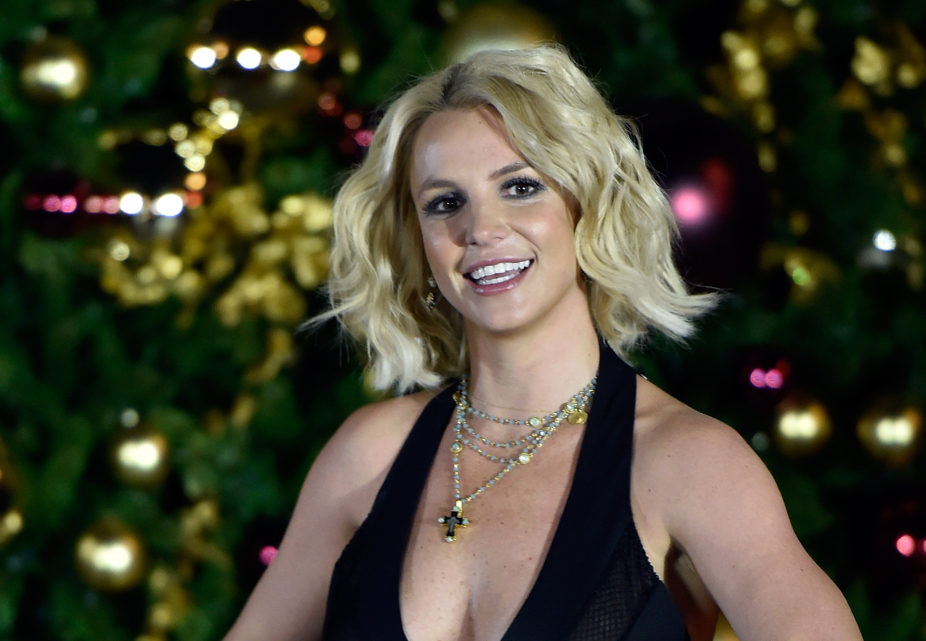 Image Source: Getty Images/David Becker |  Britney Spears arrives at a Christmas tree-lighting ceremony at The LINQ Promenade