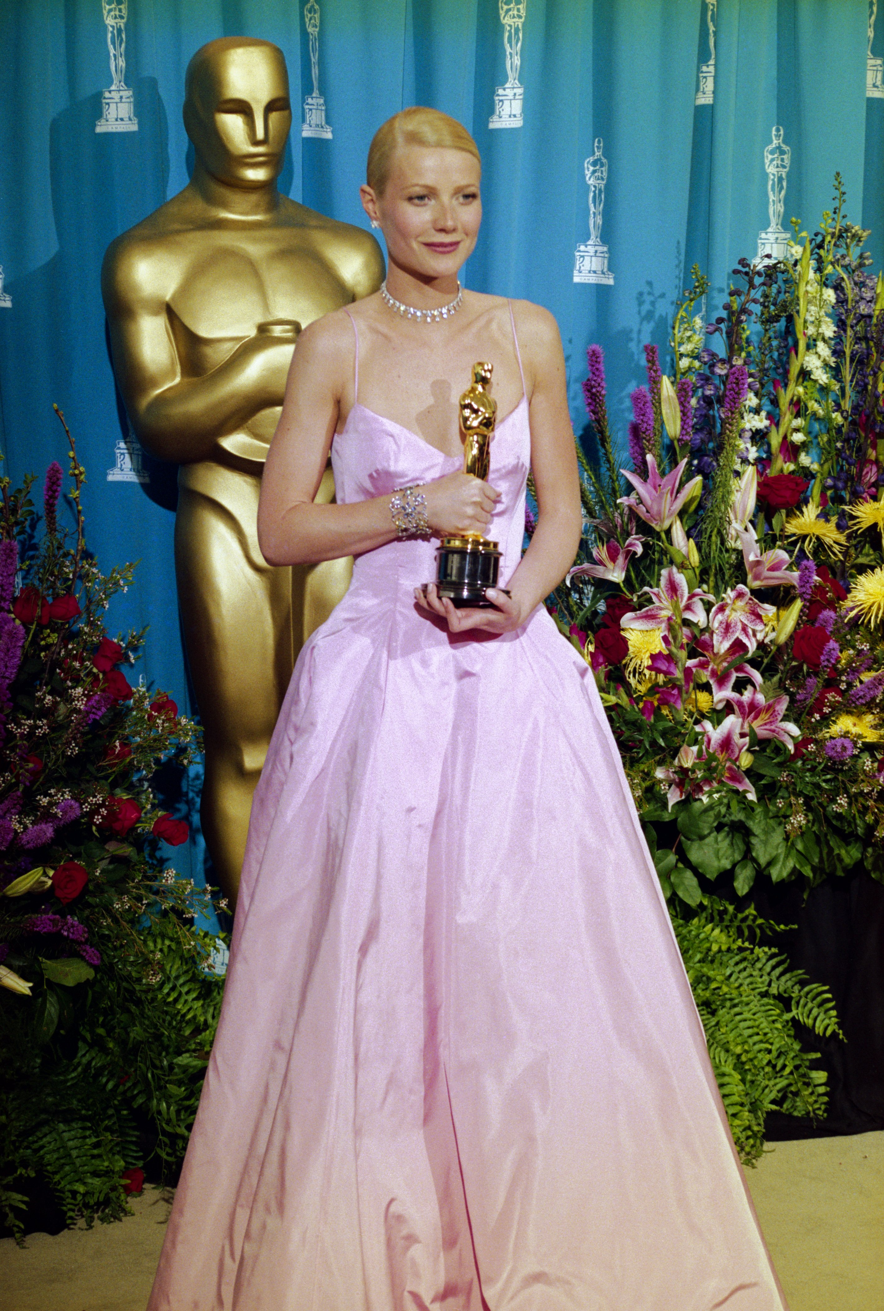 Image Credits: Getty Images / Steve Starr / Corbis | Best Actress winner for Shakespeare in Love, Gwyneth Paltrow holds onto her Oscar at the 71st Annual Academy Awards Ceremony.